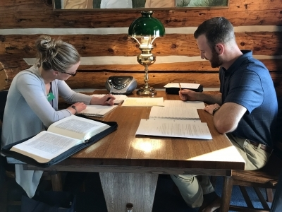 A couple studying the Word at a table