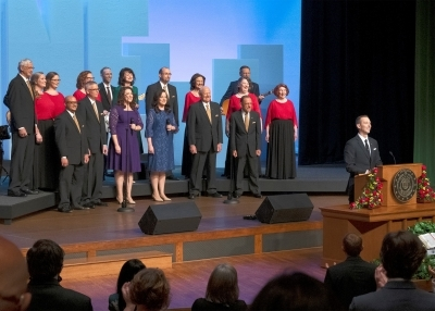 Prevailing Word Chorus Choir with Way Productions behind person at lectern